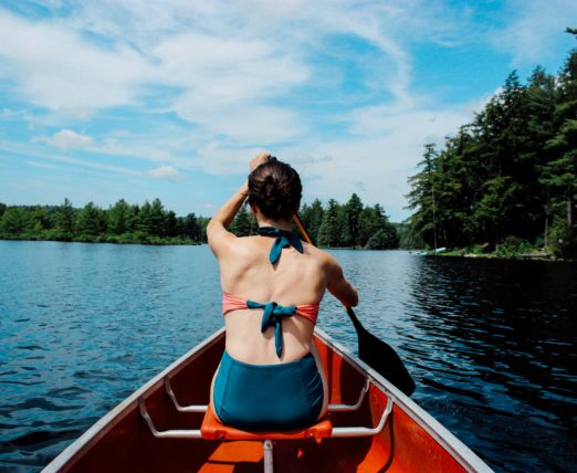 woman in canoe on the lake