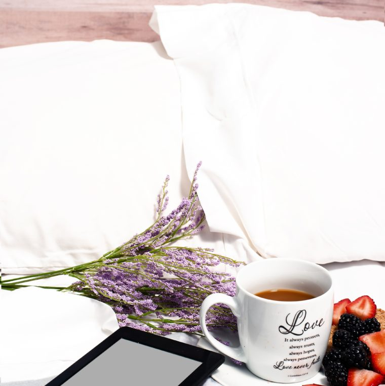 coffee, lavander, cell on a bed