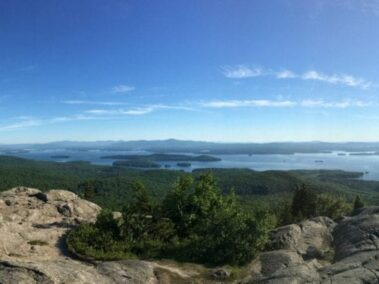 views of lake from the top of a mountain