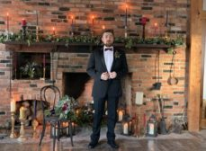 groom in front of fireplace