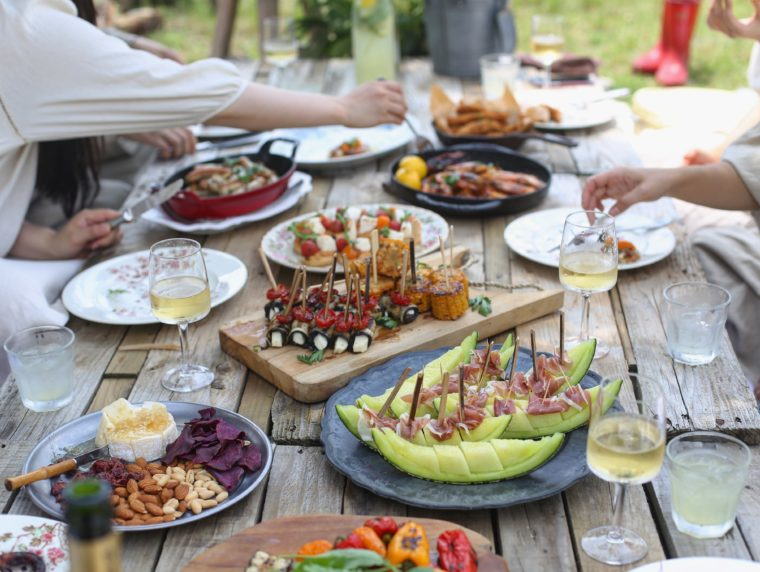 rustic table set with food while people eat