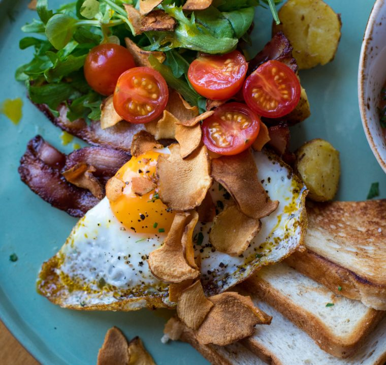 salad and fried egg with toast
