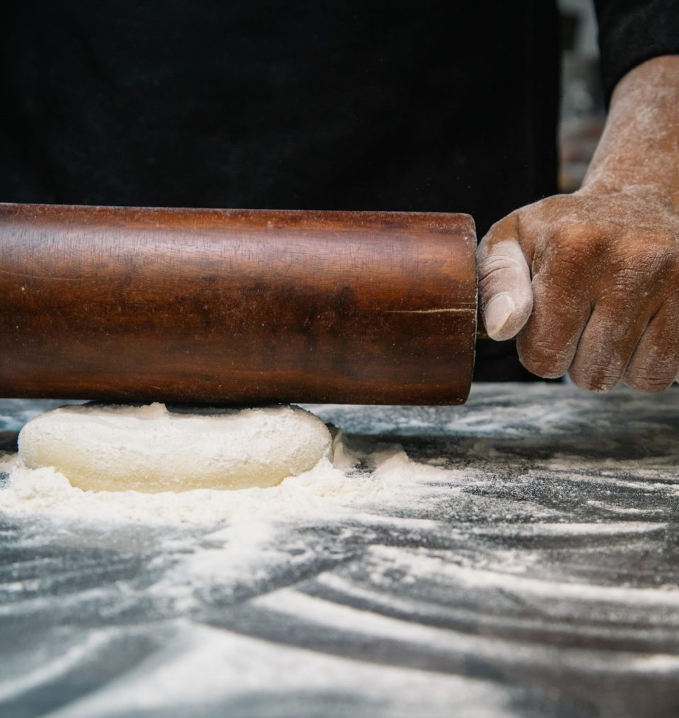 man rolling pastry