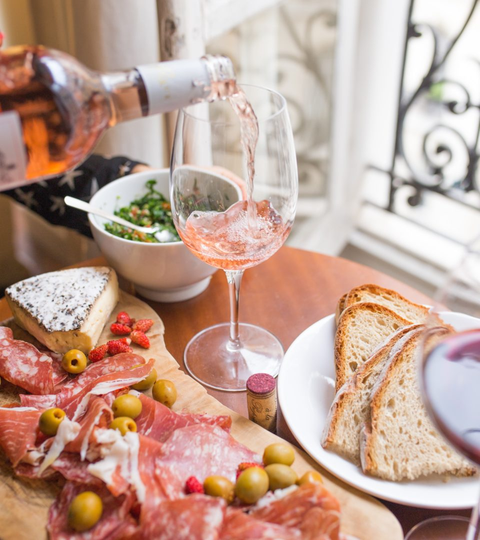charcuterie with cheese and salami and a glass of wine