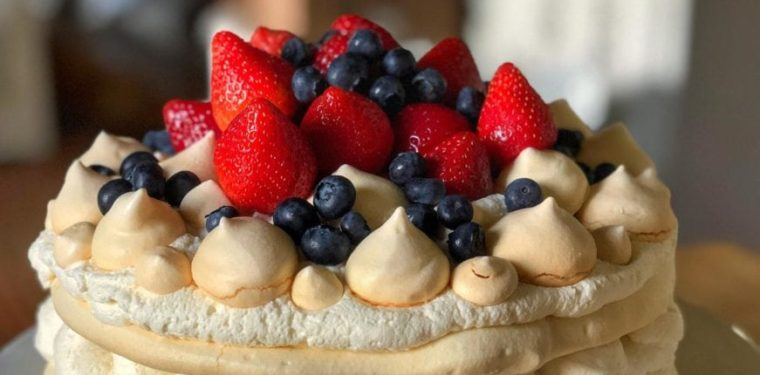 a berry pavlova made for the fourth of July and topped with fresh blueberries and strawberries